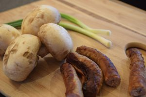 Mushrooms, onions and sausage links