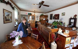 Innkeeper Liz Brown, Stagecoach Inn in Cedarburg, sets the tables for her breakfast guests...and piping hot scones may just be the specialty of the day! (JSonline photo by Rick Wood)