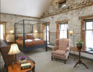 Exposed stone walls hints at the Washington House Inn's 150 year history as the first hotel in Cedarburg. As additions of cream city brick were made to the wood frame structure, the hotel operated continuously.