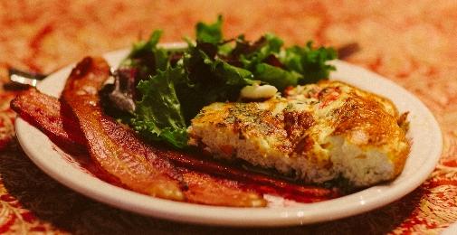 Egg Frittata Served with Bacon and Fresh Greens - Buckingham Inn