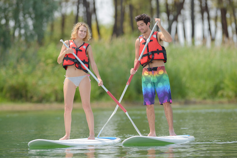 Couple Paddleboarding canstockphoto43279851