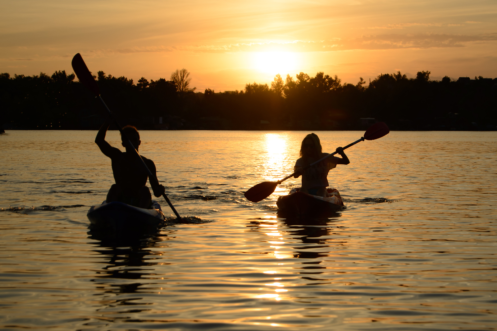 bigstock-Young-Couple-Paddling-Kayaks-o-240647467-1